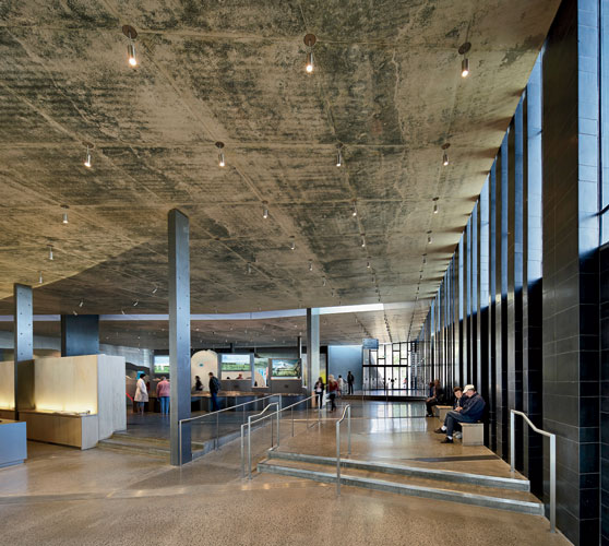 Inside, the concrete ceiling and floor have a high recycled content and'along with measures such as ground-source heating and cooling and graywater recovery'earned the building an 'Excellent' rating b