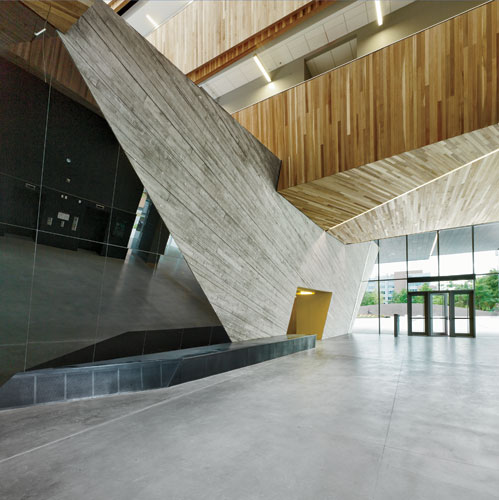 In the lobby, the poured-in-place-concrete structure  looks like an angular tree trunk.