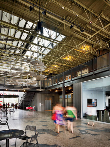 The Full Goods Warehouse, which once stored full bottles of beer, has found new life as a multi-use structure with restaurants, stores, offices, and live/work units. The architects cut skylit breezewa