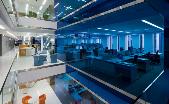 STUDIOS cut through the building's structural slabs to create a set of staggered voids that provide employees with views of several Dow Jones floors simultaneously. The resulting horizontal and vertic