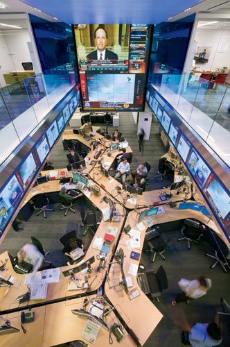 The editors responsible for the minute-by-minute decisions about what the Dow Jones publications will cover sit at clustered C-shaped desks in a double-story part of the office known as 'the hub.' LCD
