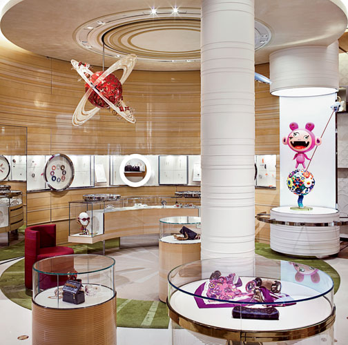 The rings of Saturn dominate the playful costume jewelry shop ' in the displays, as well as on the floor and ceiling ' where LV-branded space-age mobiles hover near a sculpture called Kiki, by Japanes