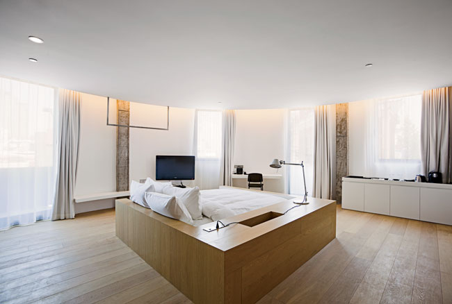In the bedrooms, the architects designed built-in desks, cabinets, and other furnishings for walls with new white surfaces. Wide-plank oak floors and oak beds complement the sleek built-ins, adding a