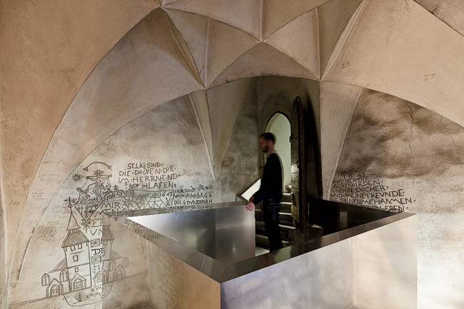 Visitors to this tiny prison cell ascend a futuristic aluminum pulpit to get a close look at well-preserved graffiti from the year 1643 that says: 'Death is certain; only uncertain is the day. Also th