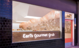Unadorned plywood forms the backside of counter seating just inside Earl's storefront and serves as the backdrop for the eatery's neon sign.