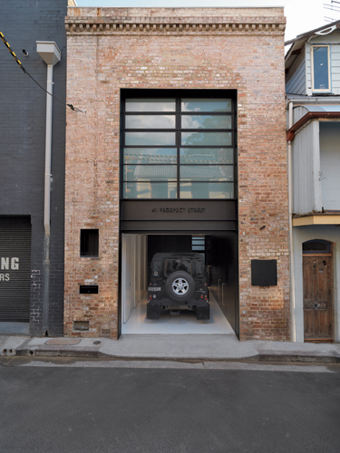 The garage, on the 882-square-foot site, opens onto a back street.
