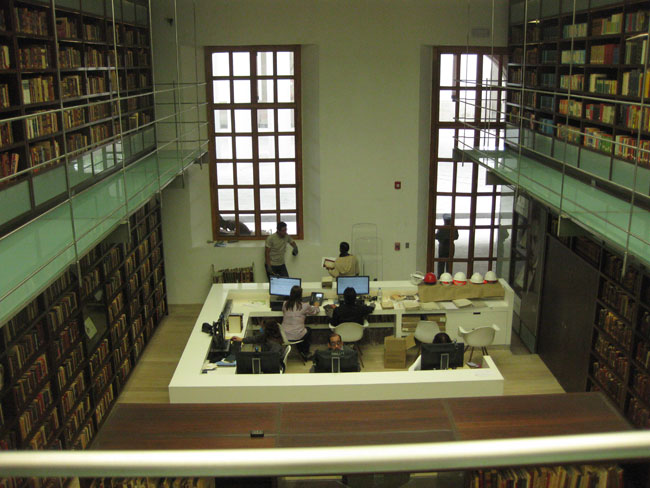 Looking down from a bridge to the circulation desk.