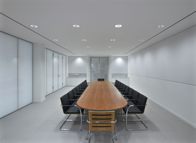 Lauren Rottet concealed a conference room with glossy, painted-glass walls and doors.