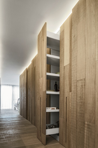 Establishing a vocabulary of smooth white surfaces contrasting against rough-sawn oak throughout the apartment, the architects devised unique configurations and furnishings to enable the client'