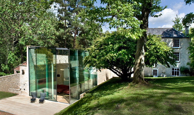 The fascia of the concrete roof is clad with soft gray aluminum to keep the color palette of the structure consistent when observed from the house's upper windows.  The pavilion's corner glass walls f