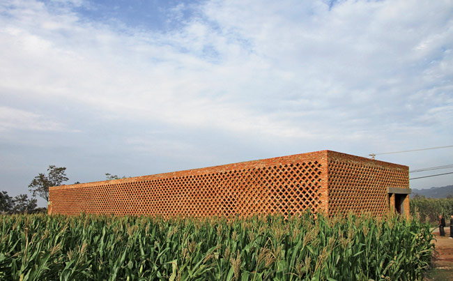 The architect was inspired to design the brick screen after a visit to the westernmost areas of China, including Kashgar in Xinjiang province. The screen helps keep the house cool in summer and warm i