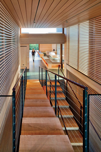 A dramatic stair leads to guest rooms on the lower level of the two-story bedroom wing.