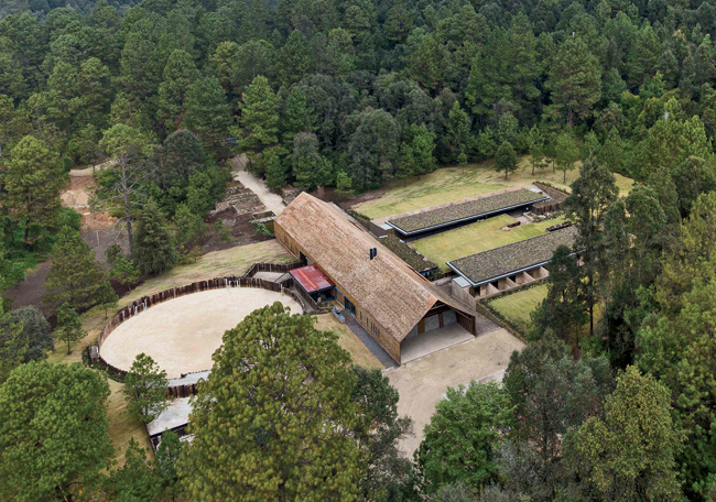 The 30,000-square-foot complex includes a freestanding main house flanked by stables and a riding ring.