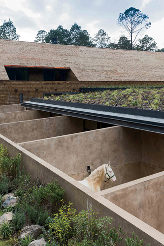 The stables feature outdoor stalls of brick covered in earth and concrete.