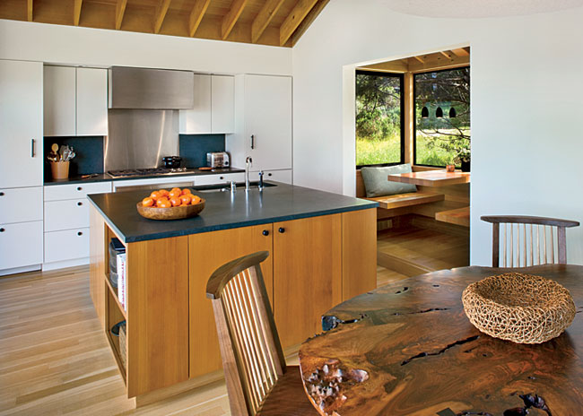Separating the kitchen from the eating area is a cedar island capped with a Bursting stone countertop.