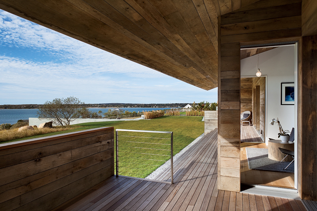 Pocket doors slide open to create a covered terrace. Rough-sawn oak, alluding to the property's previous life as a horse ranch, is seen throughout, including in the children's rooms and the master bed