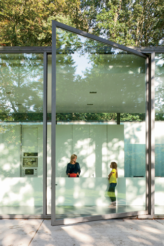 At the front of the house a large glass panel, 13.5 feet high, pivots open to allow access to the outdoors.