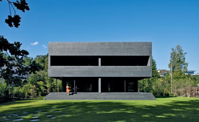Remo Halter designed a house in Luzern for himself and his family'and another family next door. The black concrete house encloses a series of terraces and outdoor walkways within its assertive volume.