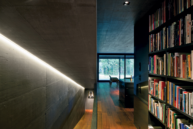 Elongated concrete ramps replace stairs within the Halter house. Brazilian cherry (Jatob') sheathes ramps and floors. They, in turn, contrast with the exposed concrete walls and ceilings.