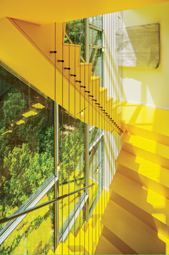 The south-facing stair plays an important role in keeping the house comfortable during the summer. The sun heats the air within its glass enclosure, creating a pressure differential that draws outdoor