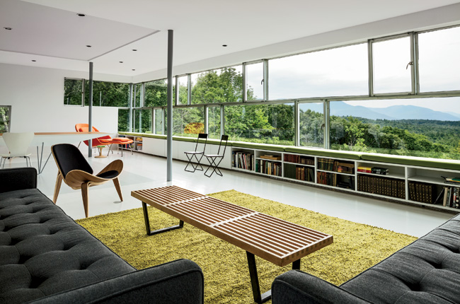 Through its ribbonlike windows, which include both fixed and operable insulated units, the main living space offers views of the Tower House's immediate environs and of the Catskill Mountains.