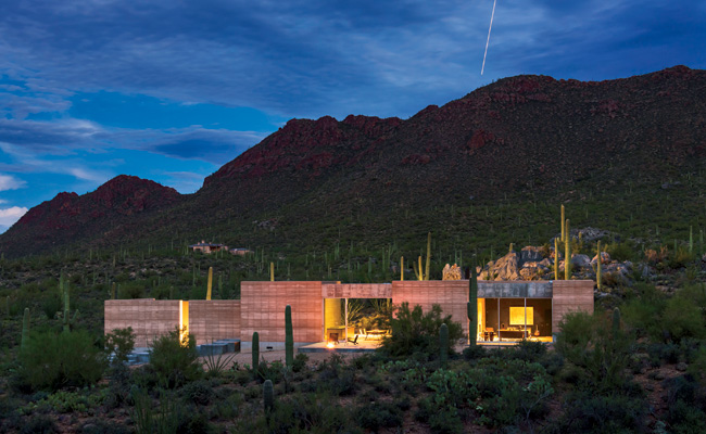 The Tucson Mountains and the desert look tough, but DUST understood how fragile they really are. So the firm limited the house's footprint and moved only five small saguaro cacti. This spring, landsca