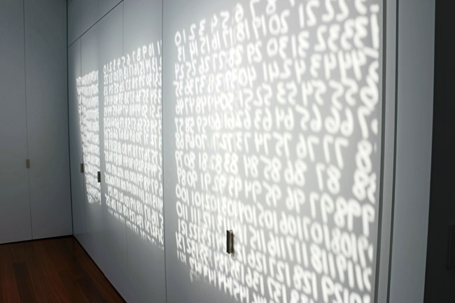 Originally created with soap on a shop window during a performance in the 1970s, the permanent version of Mel Bochner's <em>To Count: Intransitive</em> installed in the house, emblazons surrounding wa