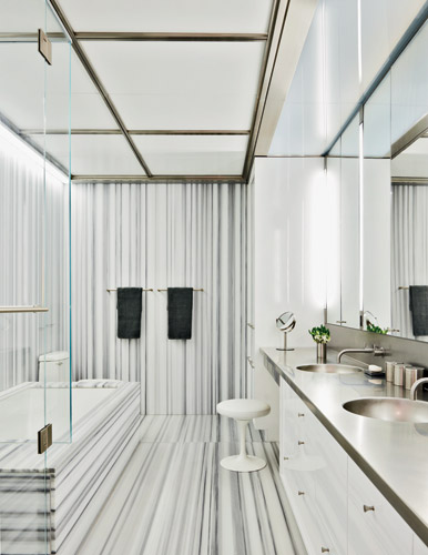 Heavily veined Linac marble gives a second-floor bathroom graphic visual punch.