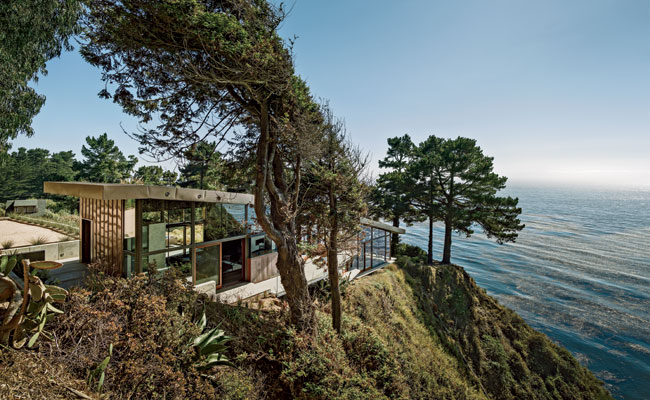 The house steps down the bluff, responding to its topography and providing a protected perch from which to take in the view.