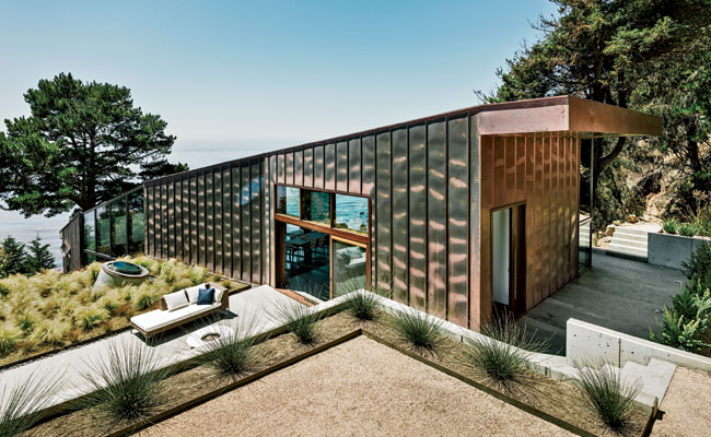"The house is clad in standing-seam copper, which holds up well against the sun and wind and sets an informal tone. ""The thing I like about copper is that it changes over time, so the house trans"