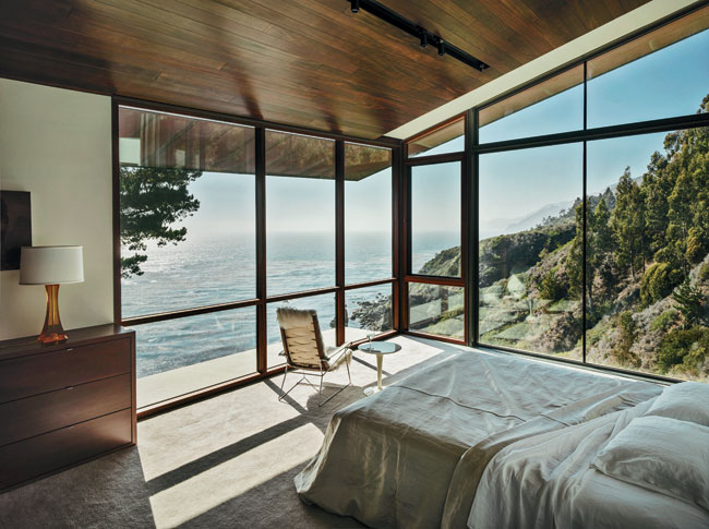 The master bedroom cantilevers out over the bluff, making the view of the coastline the primary focus.
