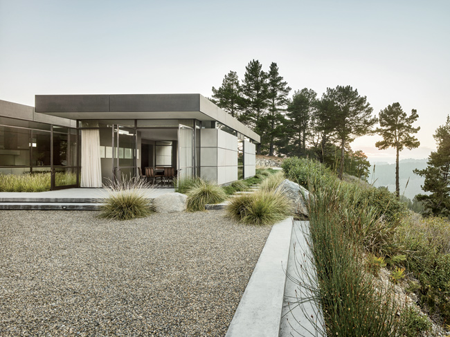The concrete-and-gravel patio off the dining area provides a crisp ledge for looking at the landscape.