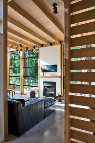 Hemlock slats create a sense both of privacy and openness throughout the house, including the living room.
