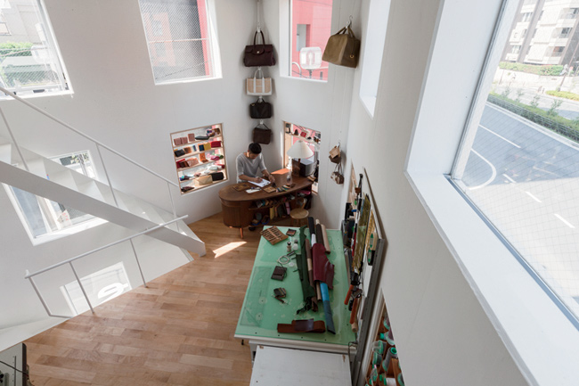 Meanwhile, inside, the ceiling heights get lower, but daylight and views improve as you ascend narrow stairs that lead up from the garage to the atelier.