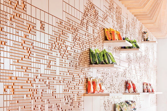 For the eatery Earl's Gourmet Grub, FreelandBuck created a mural made of white maple veneer laminated onto standard sheets of medium-density fiberboard.
