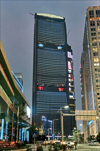 The envelope of SOM's 1,014-foot-tall tower in Guangzhou, China, includes ducts shaped to accelerate prevailing winds. Exterior lighting acts as a real-time indicator of wind-power output.