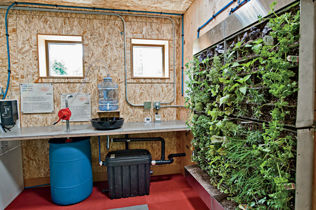 In addition to the clearly visible structure, its teaching tools include a living wall fed by treated graywater.