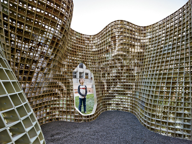 The pavilion, called Bloom, is made up of 840 individual bricks, which form a lacy floral pattern when joined together.