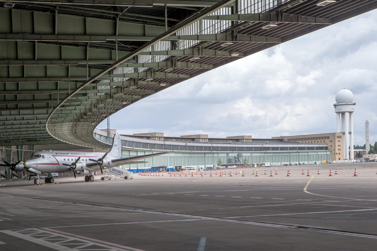 <br><h9>Tempelhof Airport by Ernst Sagebiel<br>Berlin, photo by Danica Kus, 2018</h9><p>   </p><h6><strong>DANICA KUS</strong><br> Photographer based in Ljubljana and Antwerp<p>   </p>I use a digital DSLR camera, a Canon EOS- 1D X; I can't think of the last time I used artificial lighting. I generally use a Canon 24–70 millimeter lens as well as Canon tilt-shift lenses. I prefer to shoot in blackand- white—you can express more of your feelings—but for assignments, I have to shoot in color. I started my career working in a darkroom, and the black you get there is very different from the black you get digitally. But, either way, I try to capture that atmosphere of the space and the character of the building—it's my task to show how you feel in the building. I pay attention to the play of light, the sound, smell, temperature, structures, rhythm, materials, etc. Sometimes I try to create an imaginary and ambiguous space with my camera.<p>   </p> Recently I photographed a school in Brussels. It was quite difficult, because the architects wanted to show the space being used, but the school wouldn't let me show the students' faces. And I couldn't stay more than about 20 minutes, because I was interrupting classes. Once an architect asked me to shoot a new office building during the guided tour, which lasted less than an hour—it was the only way to get access to some of the spaces. It was difficult because there was not enough time and there were too many people, but, despite the stress and speed, in the end, I was satisfied. In fact, it was such a great experience that, last summer, I shot Berlin's Tempelhof Airport during the guided tour.<p>   </p> Sometimes, when I see the work of a great architect, I'm overwhelmed. But if the building isn't beautiful, I look for something else—how the light touches the walls and floors. I always find something.</h6>