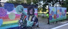 Photo of gates with images on them of Marsha P. Johnson